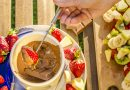 Chocolate fondue with fruits and cream