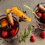 Mulled red wine with raspberries, oranges & spices