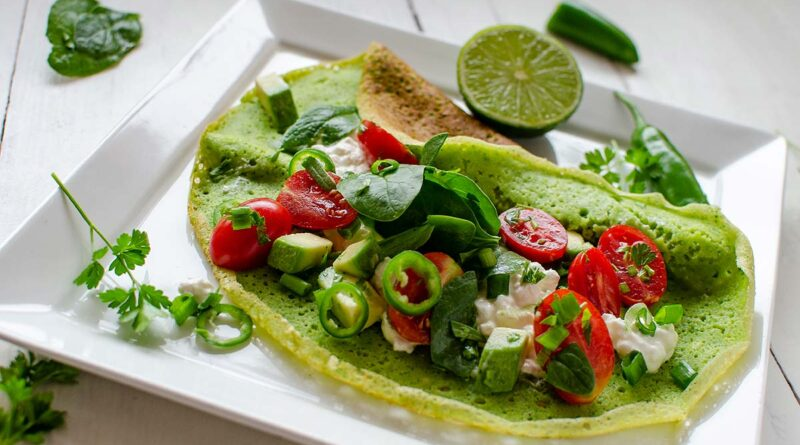 Green pancakes with spinach and salad